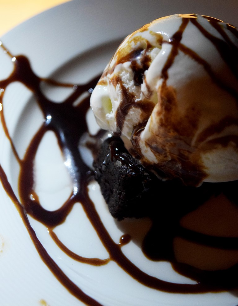 Brownie with Vanilla Ice cream and hot chocolate syrup
