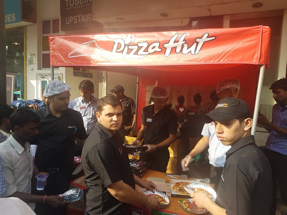 people-standing-outside-banks-receive-a-3-day-special-surprise-from-pizza-hut